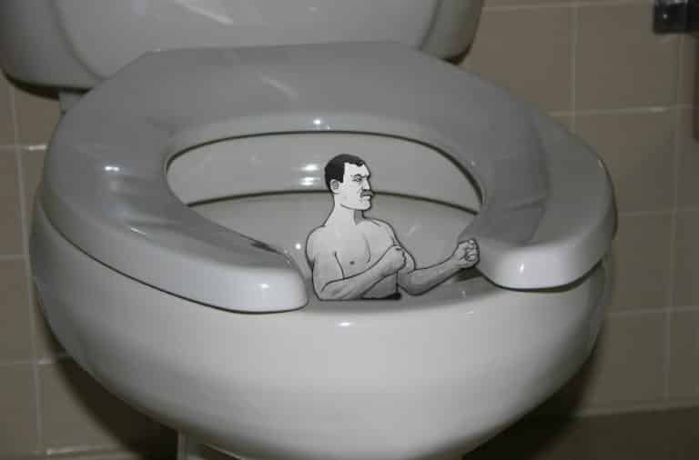Toilet seat with a muscle manly man inside