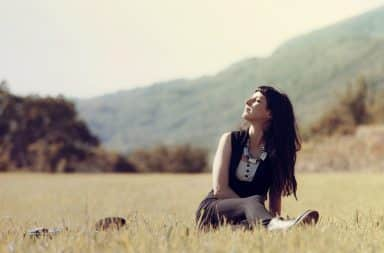 Intuitive woman thinking in a field