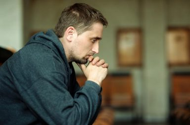 Man sitting silently in confused sadness over friend death grief