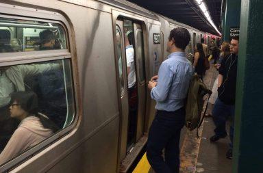 Crowded New York City subway train car