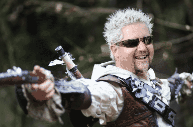 Guy Fieri holding guns