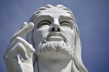 Stone Jesus face and hand