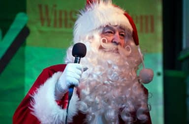Santa Claus with a microphone