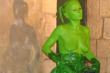 Woman covered in green goo and green body paint