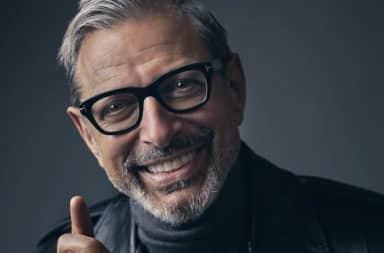 Jeff Goldblum wearing glasses giving thumbs up