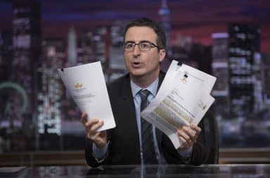 John Oliver on his show holding papers