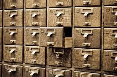 Vintage wooden card catalog drawers with brass handles