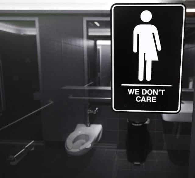 We Don't Care - bathroom sign