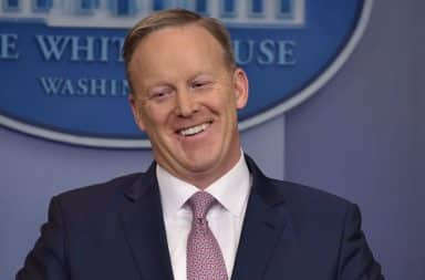 Sean Spicer laughing at podium