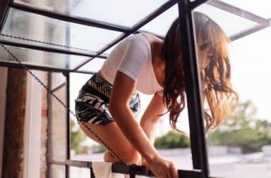 Woman climbing out a window