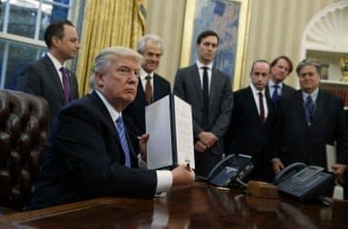 Trump holding memo at desk