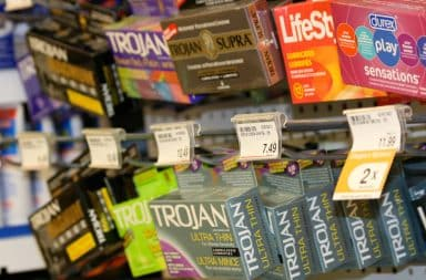 Condoms for sale on a rack in store
