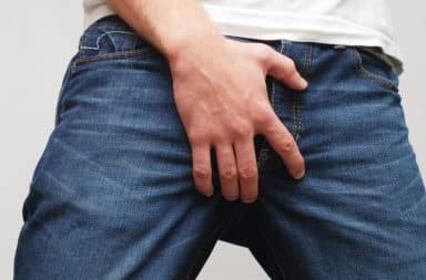 Man covering his crotch with his hand