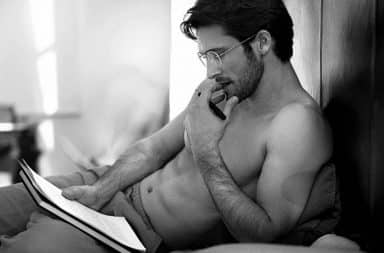 Man reading sexy in bed