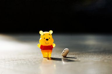 Winne the Pooh gummi bear with a pill