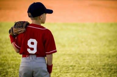 Boy pitcher in baseball league