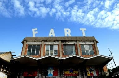 Fart sign on top of a building