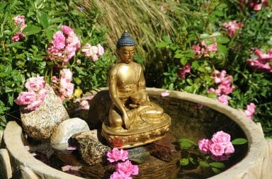Golden Buddha statue in garden