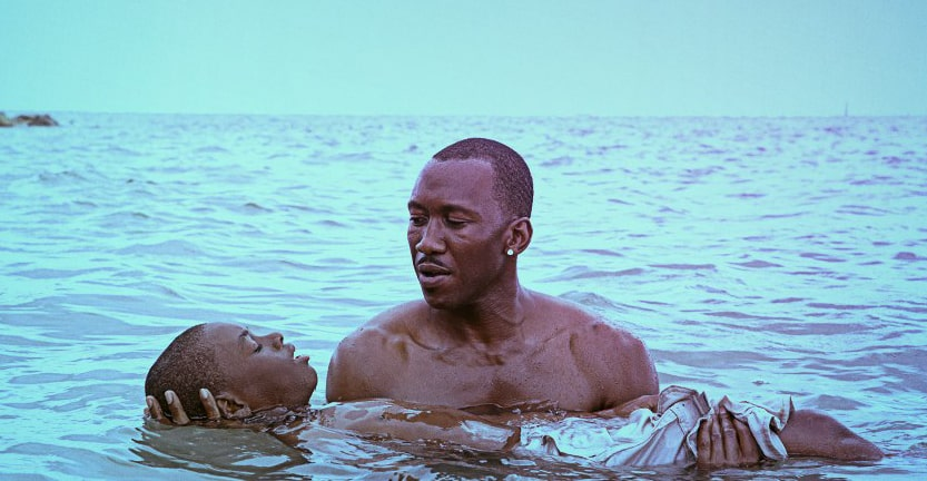 Man holding boy in the ocean in Moonlight movie