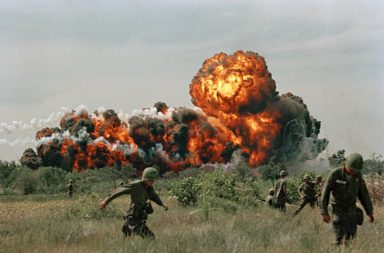 Napalm explosions in a forest during the Vietnam War