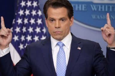 Anthony Scaramucci with his fingers pointed up at White House podium