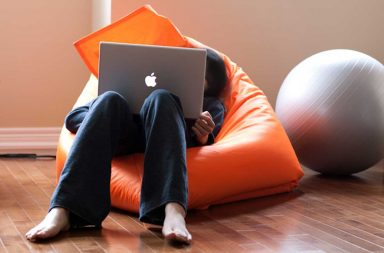 Sitting at a laptop in a bean bag chair