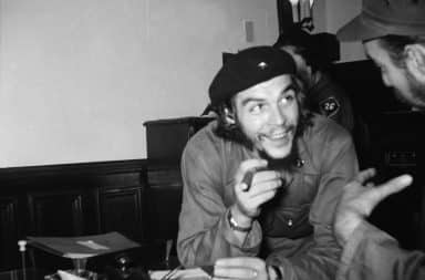 Che Guevara in Cuba smiling holding a cigar