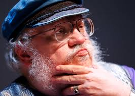 George RR Martin pondering with his hand on his beard