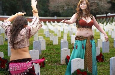 Women belly dancing on graves