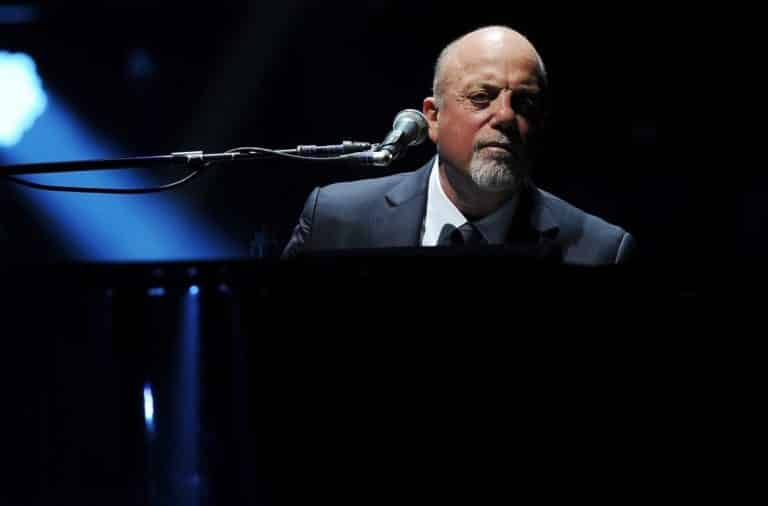 Billy Joel at a piano looking confused