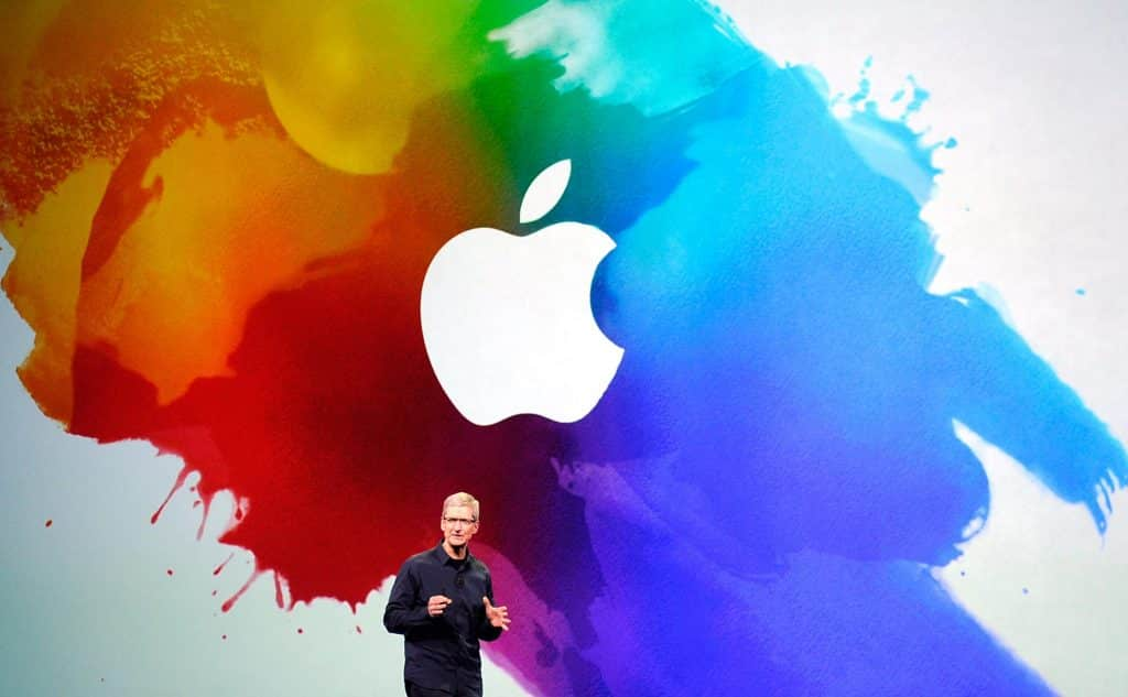 Apple speech on stage by Tim Cook with color splash