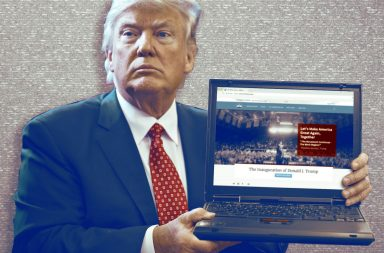 Donald Trump opening a laptop