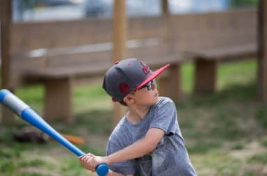 Boy swinging plastic baseball bat