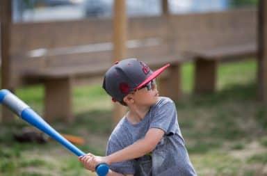 Boy swinging plastic baseball bat