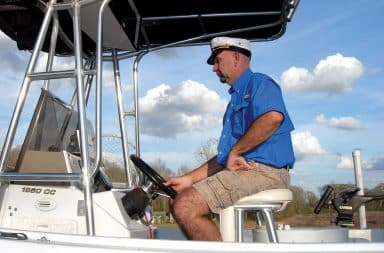 Captain at helm of fishing boat