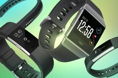 Fitbit watches on green background