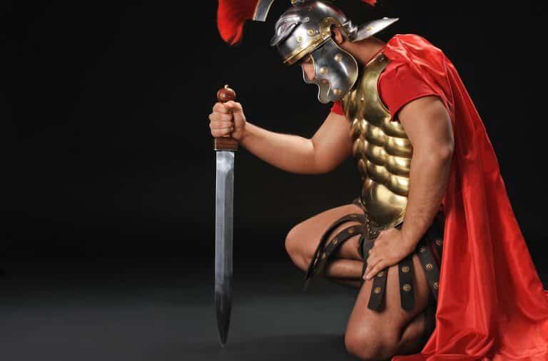 Gladiator kneeling down with a sword