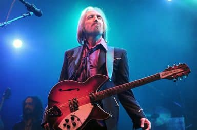 Tom Petty on stage with a guitar