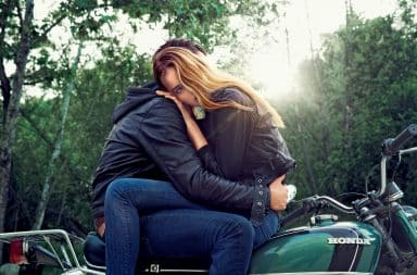 Woman hugging a man on a motorcycle