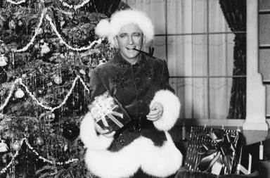 Bing Crosby in White Christmas wearing Santa Claus outfit