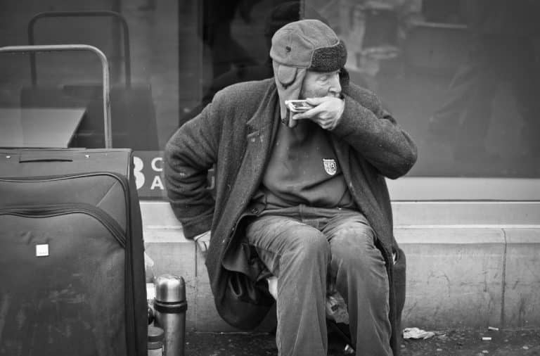 Guy playing the harmonica on the street