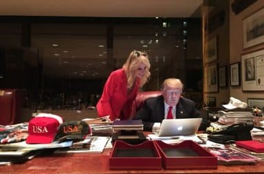 Donald Trump plays on his laptop in his office