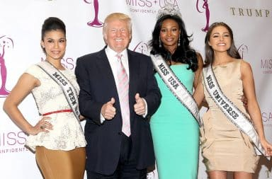Donald Trump with three beauty pageant contestant women