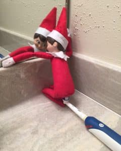 Elf on a Shelf by the toothbrushes