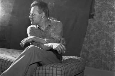 Stepdad smoking and sitting in living room vintage