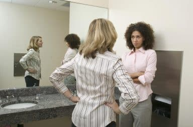 Two women talking in the bathroom