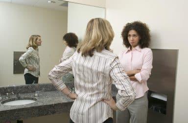 Two women talking in the bathroom