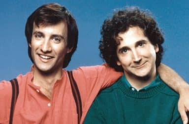 Perfect Strangers actors with arms around each other