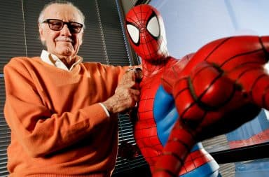 Stan Lee standing with Spiderman