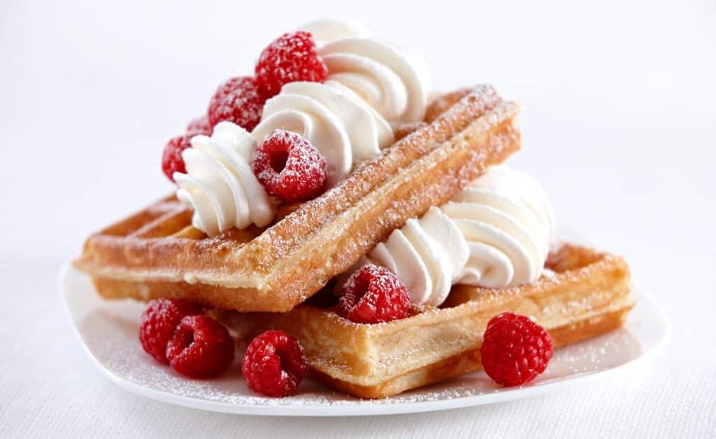 Raspberry waffles with whipped cream
